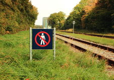 Sign prohibits access to a railway area Royalty Free Stock Photography
