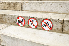 Sign prohibits dogs pass, travel on a bike and skateboard. Stock Photo
