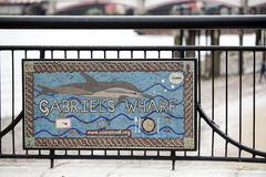 A sign promoting Gabriel`s Wharf, a redevelopment comprising independent cafes, fashion, gift and art shops at the south bank of t. LONDON, ENGLAND - March 12 Royalty Free Stock Photos