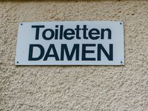 Sign for public toilets for men in German language. Reading `Toilets Ladies Stock Image