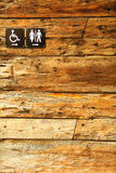 Sign of public toilets WC on wooden background Royalty Free Stock Photos