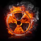Sign Radiation. In the Fire Isolated on Black Background Stock Photography