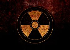 Sign of radiation danger on the rusty background. You can use as an illustration on the topic of radiation hazard, or as a screensaver the desktop background Royalty Free Stock Images