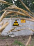 Sign radiation on the gray fence of the forbidden zone stock photo