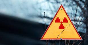 Sign of radiation hazard against radioactive waste, picture with a blured place for your text, copy space, your text here.  royalty free stock photography