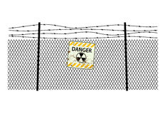 Sign radiation on  steel fencing with a barbed wire Royalty Free Stock Image