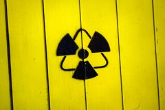 Sign of radiation on a yellow wooden board royalty free stock photos