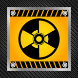 Sign of radioactivity. Radioactive hazard sign on a metal grid. Vector illustration Stock Photo