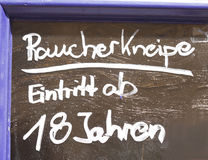 Sign Raucherkneipe. A bar where smoking is allowed in German Stock Image