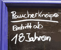 Sign Raucherkneipe. A bar where smoking is allowed in German Royalty Free Stock Photography