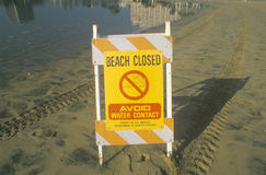 A sign reading �Avoid Water Contact� warning people that a beach at Marina del Rey, Los Angeles, CA, is closed due to pollutio Royalty Free Stock Photo