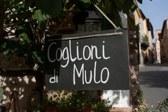 Sign reading Coglioni di Mulo (Mule's balls), a typical salami royalty free stock photo