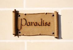 Sign reading Paradise. Ceramic sign on a wall reading Paradise Stock Image