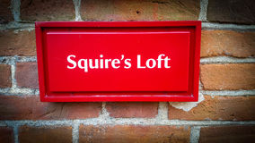 Sign reading Squire`s Loft. A red sign reading Squire`s Loft at national trust Stock Photos