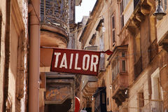 Sign reading Tailor in Valletta, capital city of Malta Stock Images