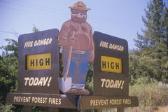 A sign that reads �Fire danger high today� Royalty Free Stock Photography