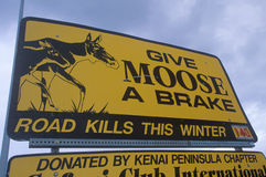 A sign that reads �Give moose a brake� royalty free stock photography
