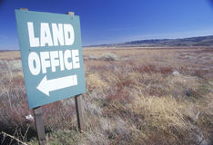 A sign that reads �Land Office� Royalty Free Stock Photography