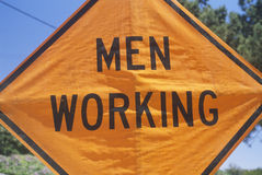 A sign that reads �Men working� Royalty Free Stock Photography