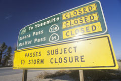 A sign that reads �Passes subject to storm closure�. A sign that reads �Passes subject to storm closure stock photos
