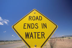 A sign that reads �Road ends in water� Royalty Free Stock Image