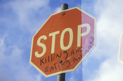 A sign that reads �Stop killing and eating animals� Stock Image
