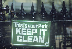 A sign that reads �This is your park - Keep it clean� Royalty Free Stock Photos