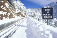 A sign that reads �Chains or Snow Tires Required� stock images
