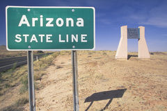 A sign that reads Arizona State Line Royalty Free Stock Photography