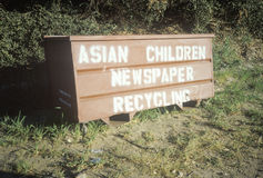 A sign that reads �Asian Children Newspaper Recycling� Royalty Free Stock Photo