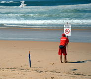 A sign reads beach closed. Royalty Free Stock Images
