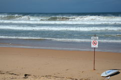 A sign reads beach closed. Royalty Free Stock Photo