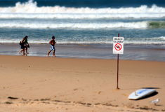 A sign reads beach closed. Royalty Free Stock Photography