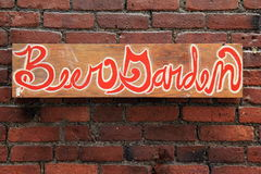 Sign that reads 'Beer Garden' on brick wall Stock Photography