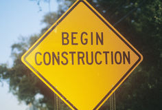 A sign that reads �Begin Construction� Stock Photography