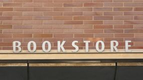 Bookstore Sign. A sign that reads Bookstore against a brick wall stock photography