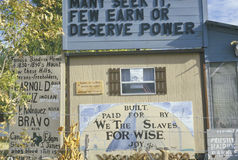 A sign that reads �Built, paid for by we the slaves for wise joy� Stock Photo