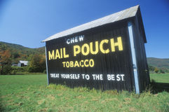 A sign that reads �Chew Mail Pouch Tobacco - Treat Yourself to the Best� Royalty Free Stock Photo
