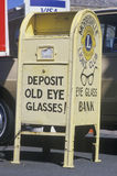 A sign that reads �Deposit old eye glasses� Stock Photo