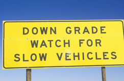 A sign that reads �Down grade watch for slow vehicles� Stock Image