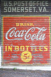 A sign that reads �Drink Coca-Cola in Bottles 5c� Stock Image