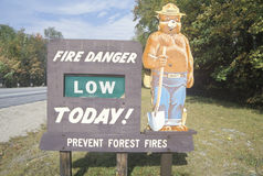 A sign that reads �Fire danger low today� Royalty Free Stock Images
