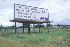 A sign that reads �Govts. Don�t create wealth, they confiscate and give it to the lazy and the poor� Royalty Free Stock Image