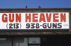 A sign that reads Gun Heaven Stock Photography