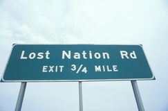 A sign that reads �Lost Nation Rd - Exit 3/4 mile� Stock Images
