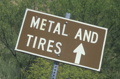 Sign reads metal and tires Royalty Free Stock Photography