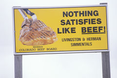 A sign that reads �Nothing satisfies like beef� Stock Photos