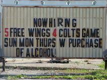 Sign that reads, Now hiring 5 free wings stock photos