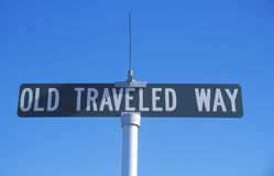 A sign that reads �Old Traveled Way� Stock Photography
