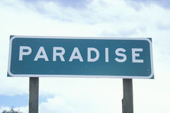 A sign that reads Paradise Stock Image